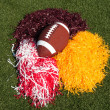 American Football and Pom Poms on Field - Foto Stock