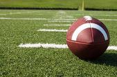 Closeup of American Football on Field — Stock Photo
