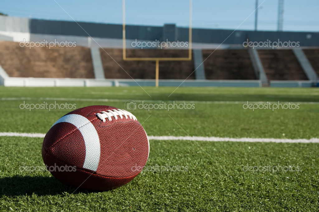 American football on field with goal post in background. — Stock Photo #3693599