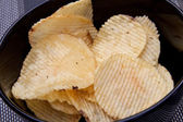 Potato chips served on the table — Stock Photo
