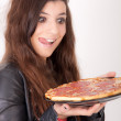 Hungry woman holding a pizza — Stock Photo #3357209