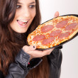 Hungry woman holding a pizza — Stock Photo #3357225