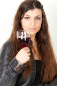 Beautiful brunette is drinking wine — Stock Photo