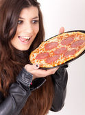 Hungry woman holding a pizza — Stock Photo