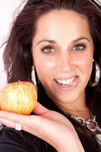 Woman is holding a apple — Stock Photo