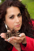 Brunette with pince cones — Stock Photo