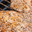 Meat on the electric barbecue — Stock Photo