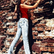 Unforgettable model standing near old wall. — Stock Photo #3343150