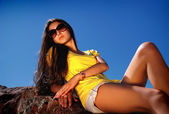 Charming lady in glasses resting on sun. — Stock Photo