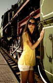 Lady in glasses next to old train. — Stock Photo