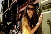 Close up of lady in glasses next to old train. — Stock Photo