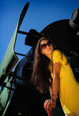 Beautiful she-model stanging on a train. — Stock Photo