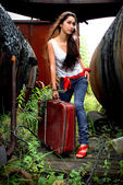 Stylish image of girl with red suitcase. — Stock Photo