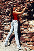 Unforgettable model standing near old wall. — Stock Photo