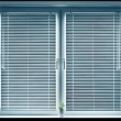 Window with blinds isolated on black. — Stock Photo #3363927