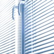 Window with blinds isolated on white. - Stock Photo