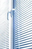 Window with blinds isolated on white. — Stock Photo