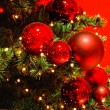 Stock Photo: Christmas tree on red background.