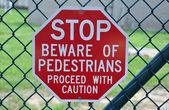 Pedestrian walking stop sign — Stock Photo