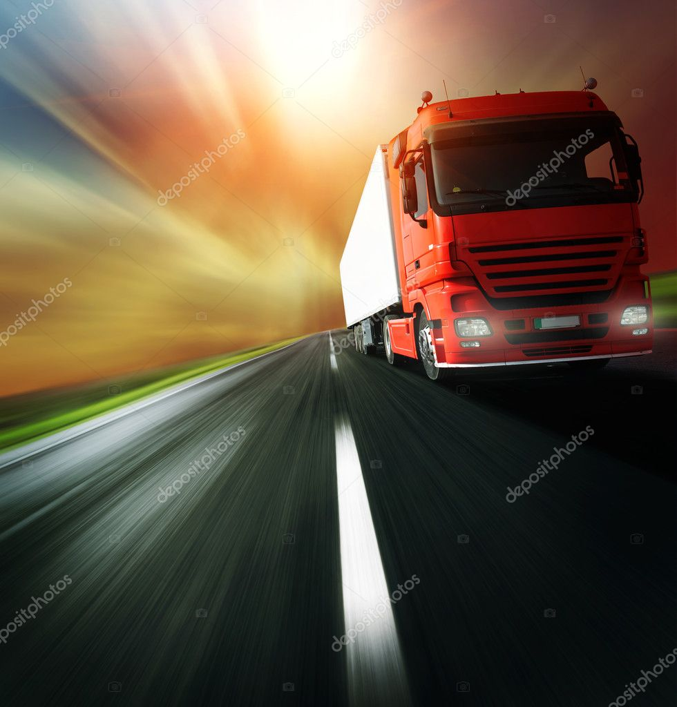 Red truck on blurry asphalt road over cloudy sky background — Stock Photo #3271482