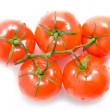 Fresh red tomatoes on a white background — Stock Photo
