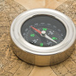Stock Photo: Map and compass on a white background