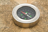 Map and compass on a white background — Stock Photo