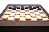 Checkers on a board — Stock Photo
