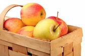 Яркие яблоки в плетеной корзине — Stock Photo