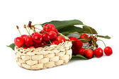 Sweet cherry berries in a basket on a white background — Stock Photo