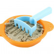 Sieve with sand and rake — Stock Photo