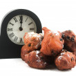 Dutch oliebollen withe clock - Stockfoto