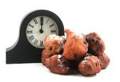 Dutch oliebollen withe clock — Stock Photo