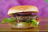 Beef burger in a bread bun — Stock Photo