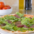 Meat pizza with green topping — Stok fotoğraf