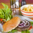 Stock Photo: Beef burger in bun with salad