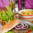 Beef burger in a bun with salad — 图库照片