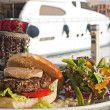Gourmet beef burger with motor yacht — Stock Photo #3183887
