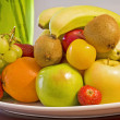 Bowl of fresh fruit on a table — Stok fotoğraf