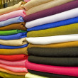 Fabrics on a market stall — Stock Photo