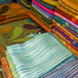 Fabrics on a market stall — Foto de Stock