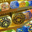 Glass bowls in a market stall — Stock Photo
