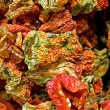 Dried capsicums at a market stall — Stock Photo
