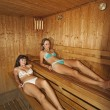 Two young girls in a steam room — Stock Photo