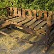Rustic bench in a park — Stock Photo