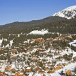 Mountain village in the snow - Stock Photo