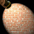 Spotlight frame on a brick wall - Foto Stock