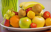 Bowl of fresh fruit on a table — Stock Photo