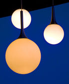 Three balls lamps hanging on a patio — Stock Photo