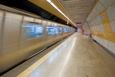 Metro train approaching a station — Stock Photo